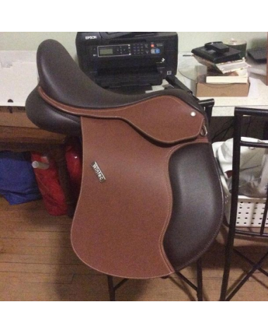 Barely used Wintec with stirrups, girth, cover, and leathers