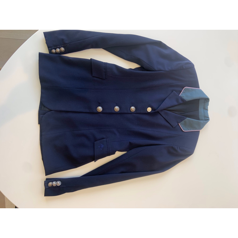 Custom Allon show coat with light pink stitching.